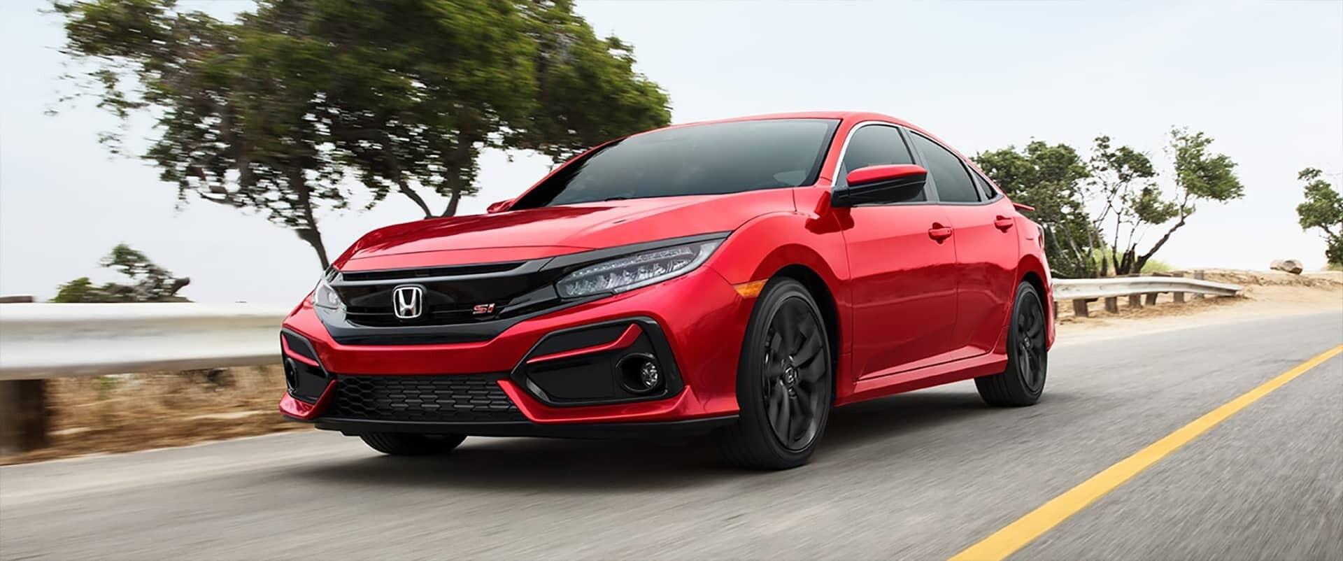 2020 Honda Civic Si Sedan driving on road