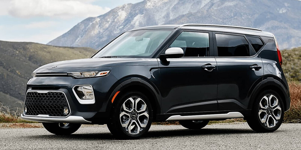 Kia Soul parked with mountains in background