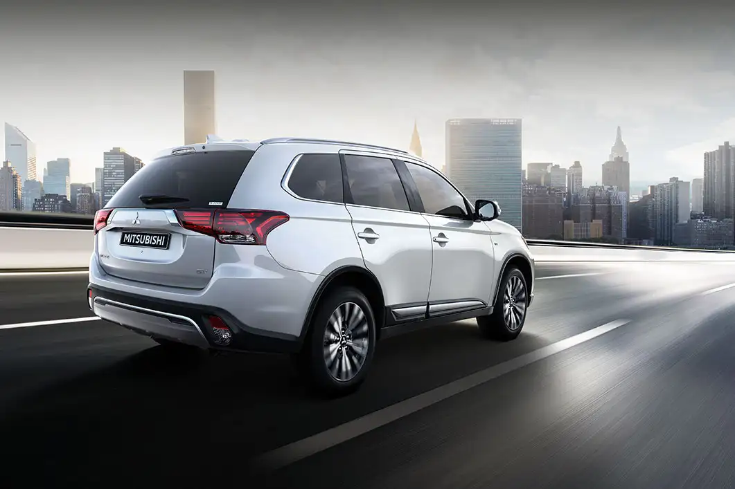 2020 Mitsubishi Outlander driving to the city
