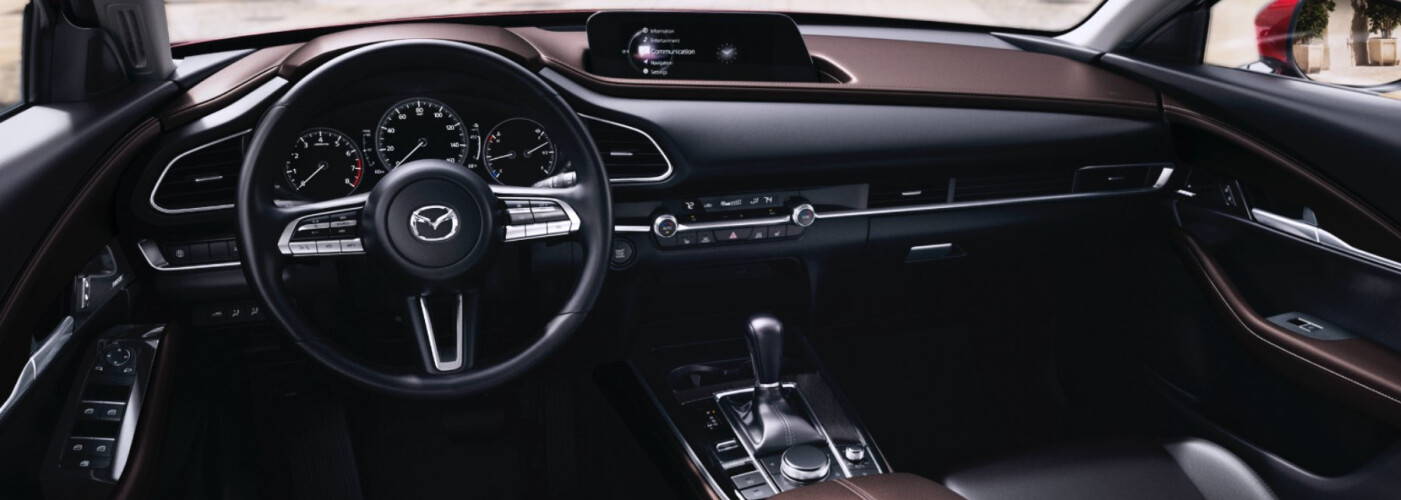 a locked Mazda steering wheel on a vehicle