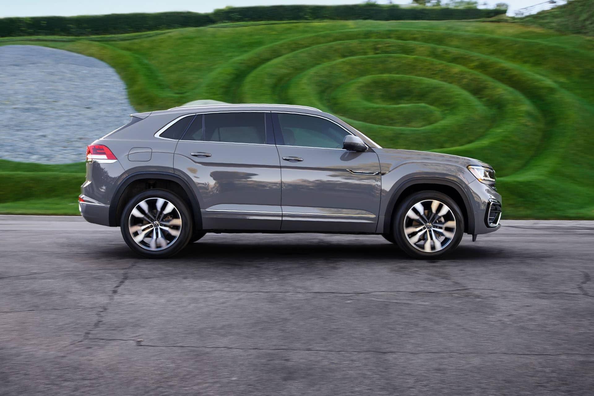 2020 VW Atlas Cross parked by a grassy hill