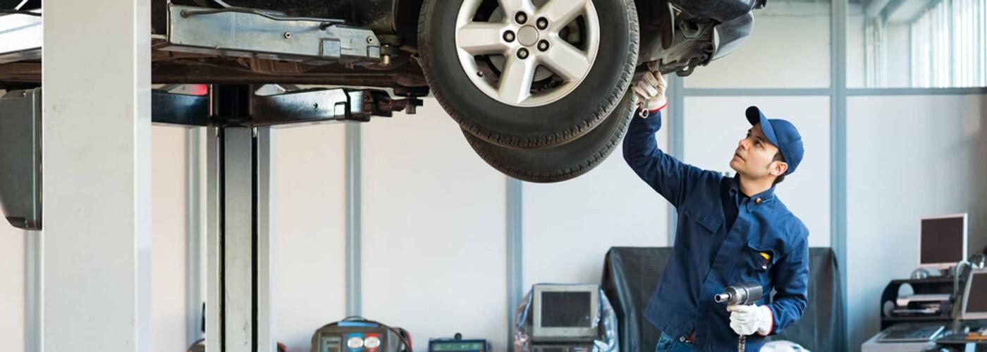 a toyota technician servicing a vehicle