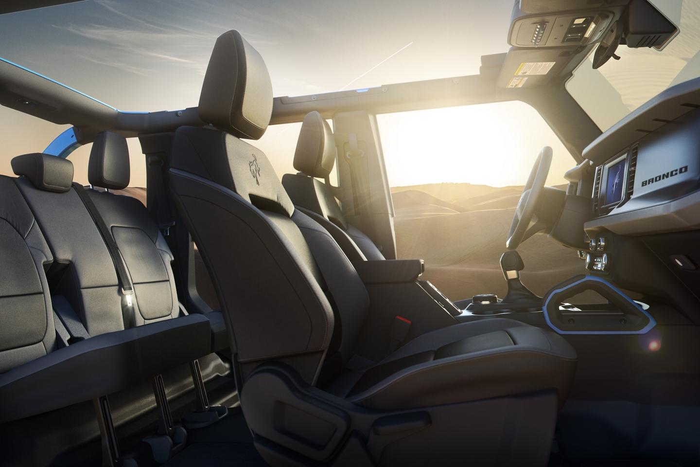 2021 Ford Bronco interior and sunset in background