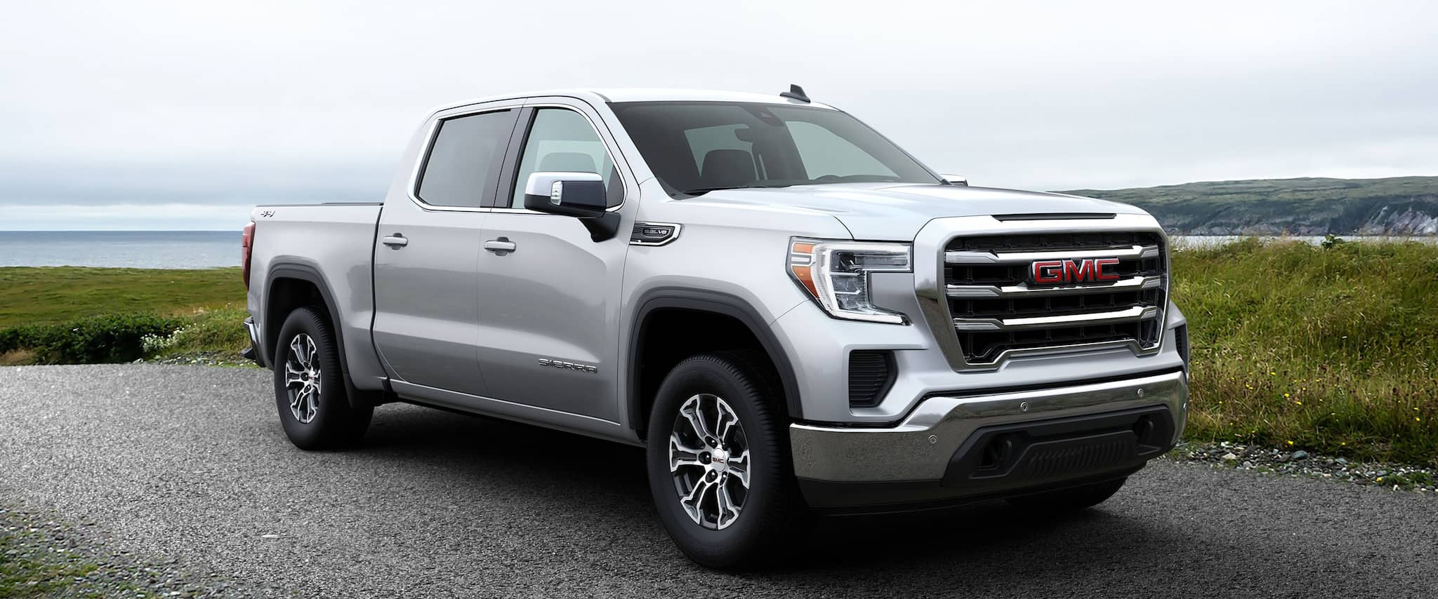 2019 GMC Truck parked by a beach
