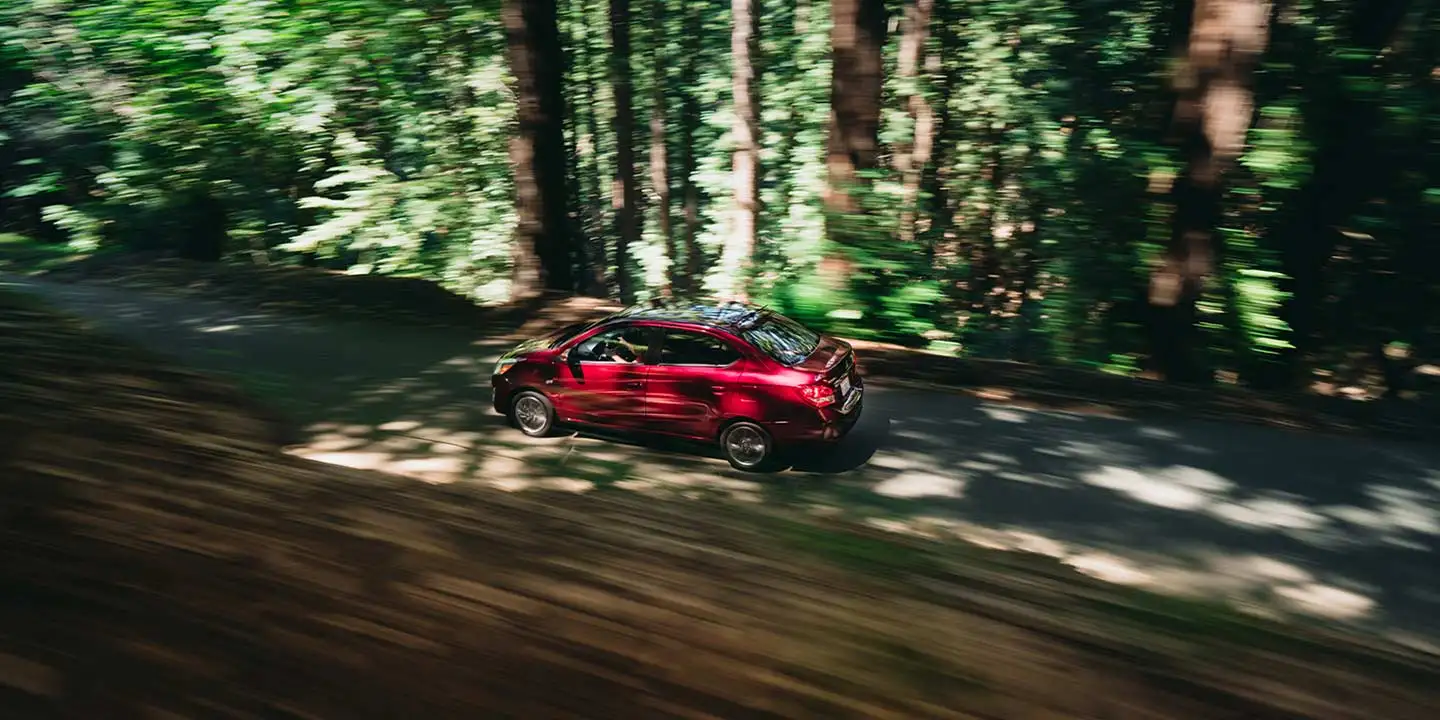 2020 Mitsubishi Mirage G4 driving on a wooded road