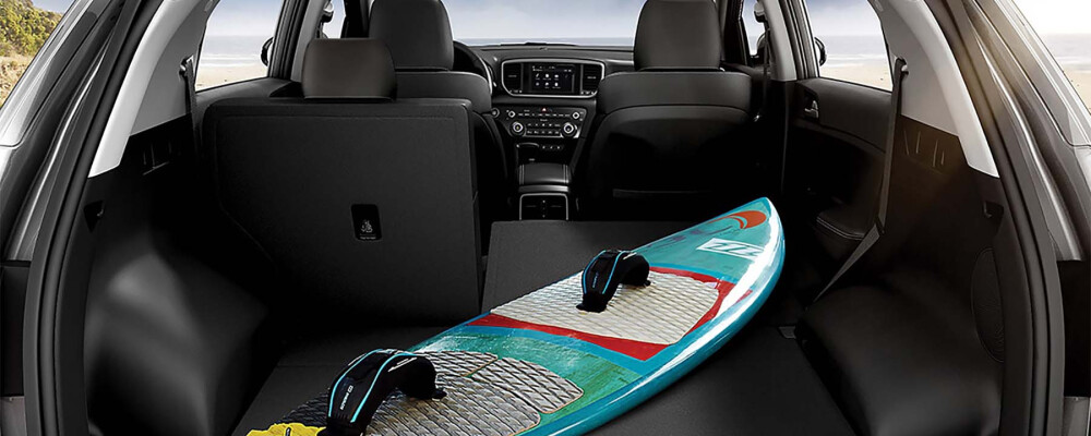 Surfboard in cargo area of Kia Sportage