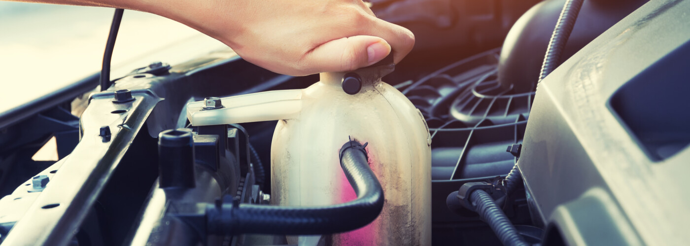 a car owner checking their coolant level