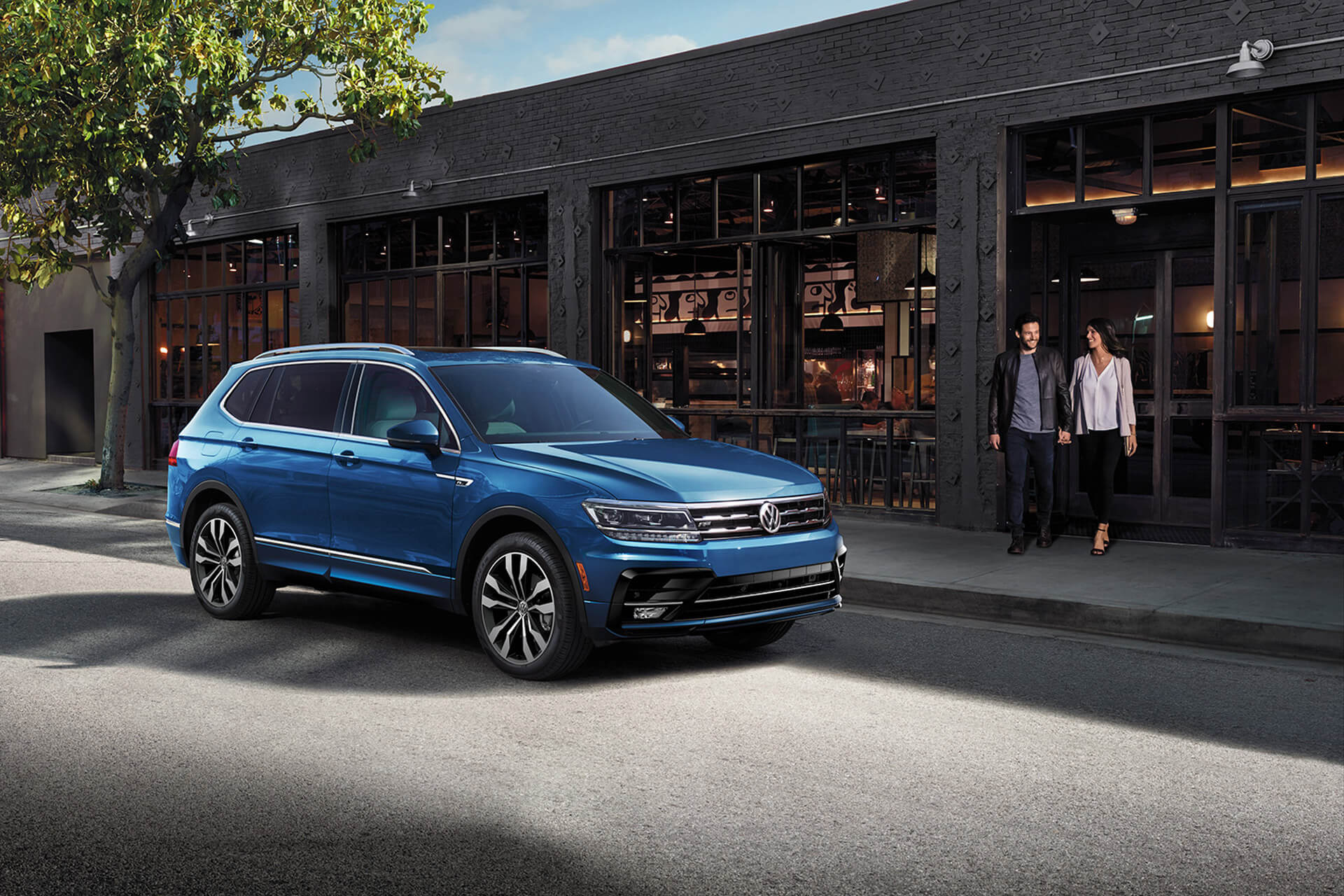 2020 VW Tiguan parked in front of a trendy restaurant