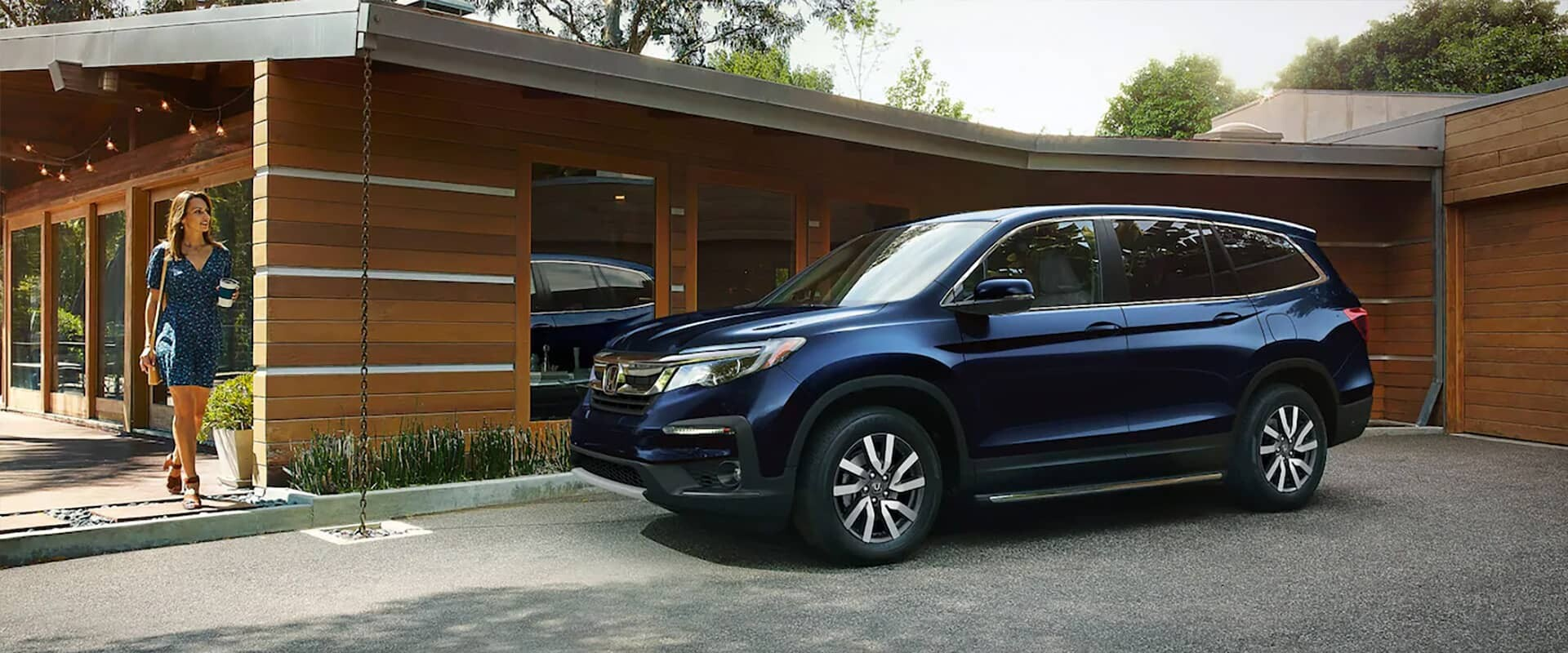 2020 Honda Pilot EX-L parked in driveway