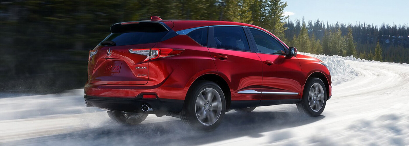 a 2021 Acura RDX driving down the road with accesories installed