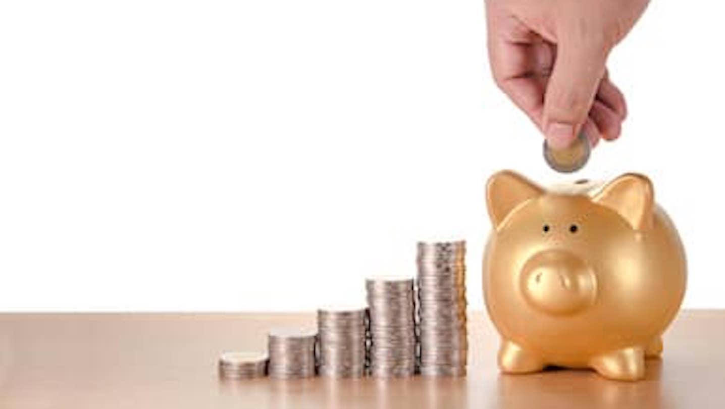 A person saving money in a piggy bank
