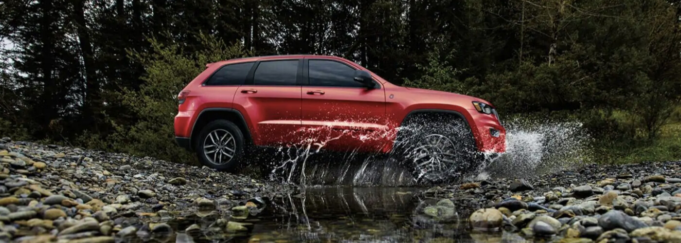 the newly redesigned Jeep Grand Cherokee driving through a river